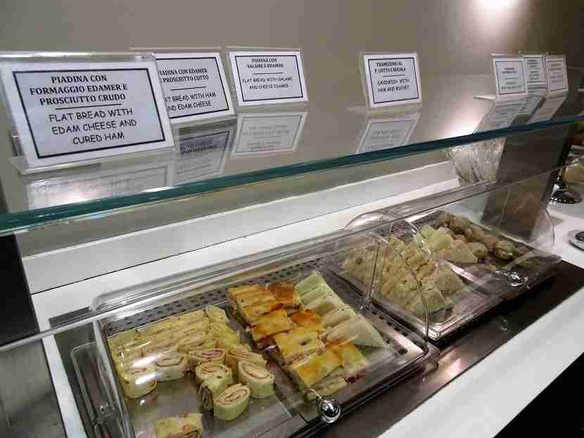 Enjoy a variety of tiny bilingual sandwiches.