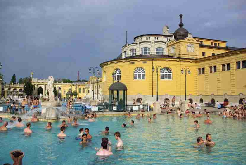 Szechenyi Thermal Bath, a highlight of Városliget, and the largest medicinal bath in Eastern Europe, is housed in a neo-Baroque palace built in 1913. The water temperature is always 100.4 degrees Fahrenheit. Image courtesy of Andia/UIG via Getty Images.
