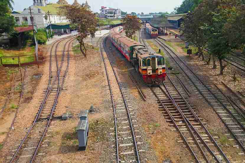 The Yangon Central Railway offers a unique view of the city and its surrounding communities, and is a cheap way to see amazing attractions. Image courtesy of Fraser Robertson/Getty Images.