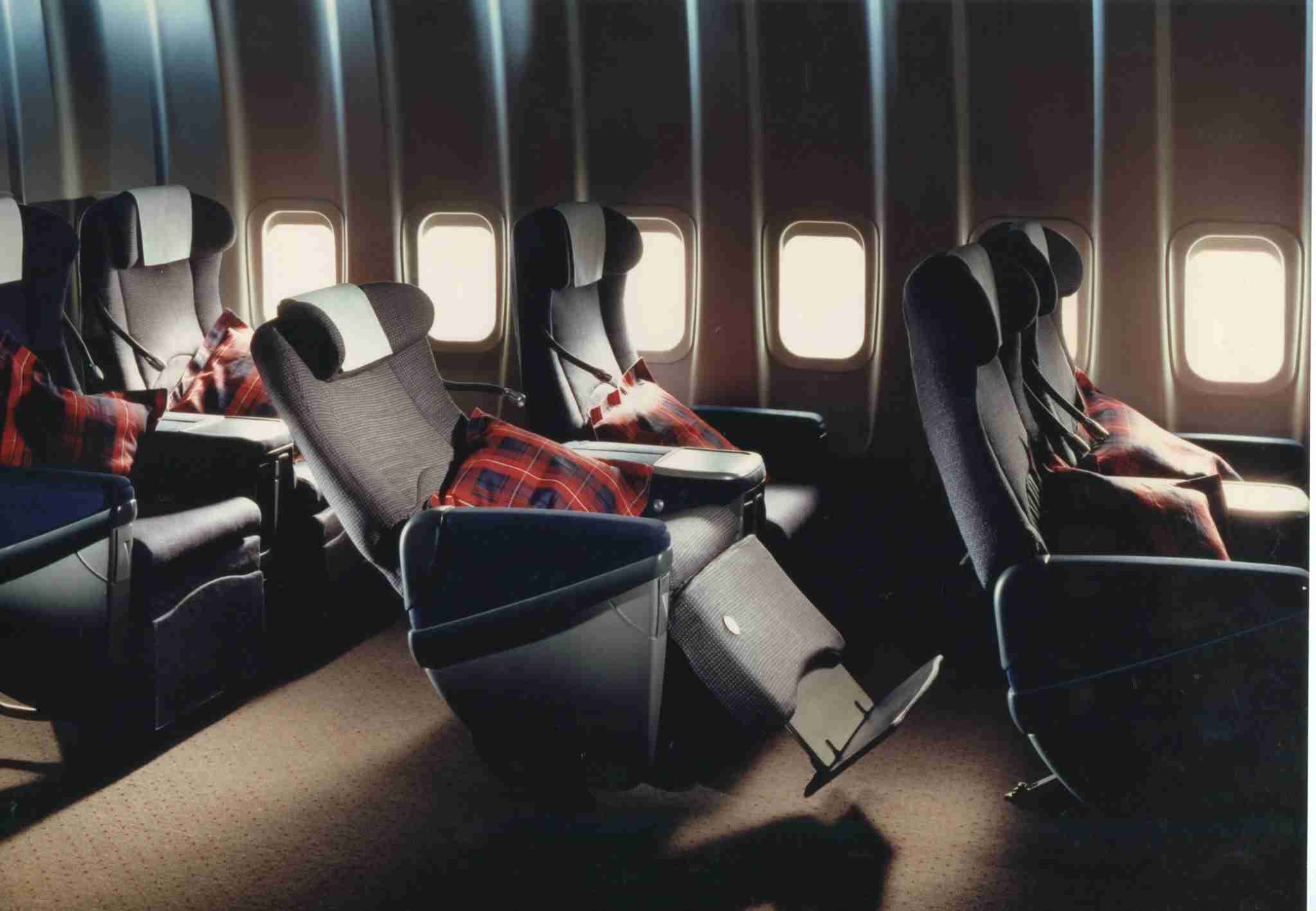 Before becoming the first airline to offer fully flat beds in business class, British Airways transported business passengers in Club World cradle seats, replete with adjustable footrests and headrests. Image courtesy of British Airways.