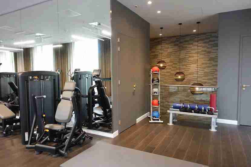 Some of the weight machines and the stretching area.