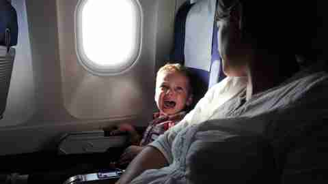 Crying boy on plane