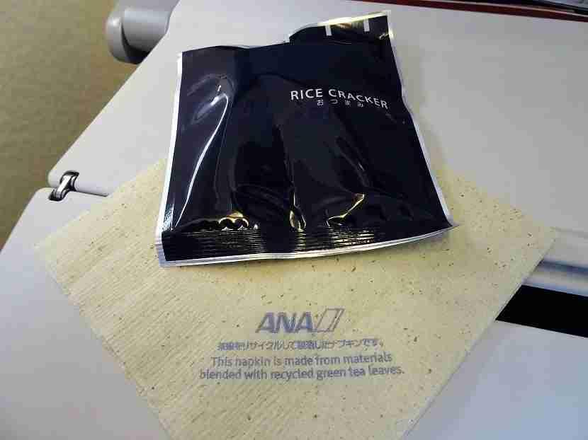 Rice crackers and an environmentally friendly napkin.