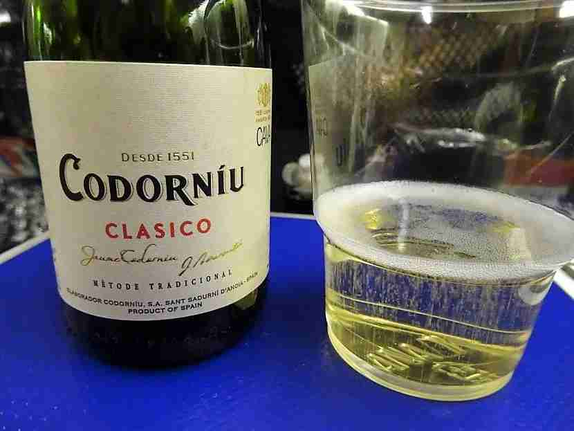 An American drinking Spanish Wine on a Japanese flight to Singapore.