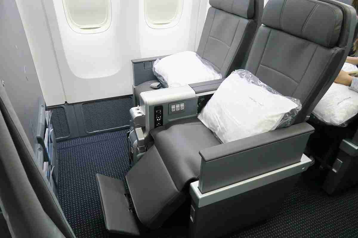 AA 772 premium economy bulkhead seats with legrest