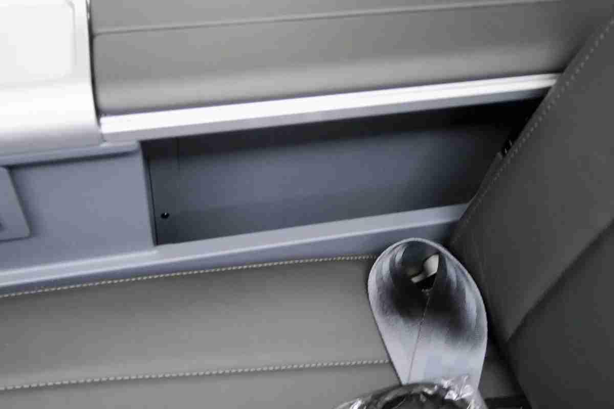 AA 772 premium economy storage well