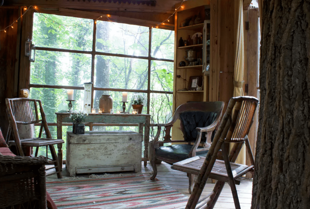 The tree house is filled with antique furniture and classic design elements. Photo courtesy of Airbnb.