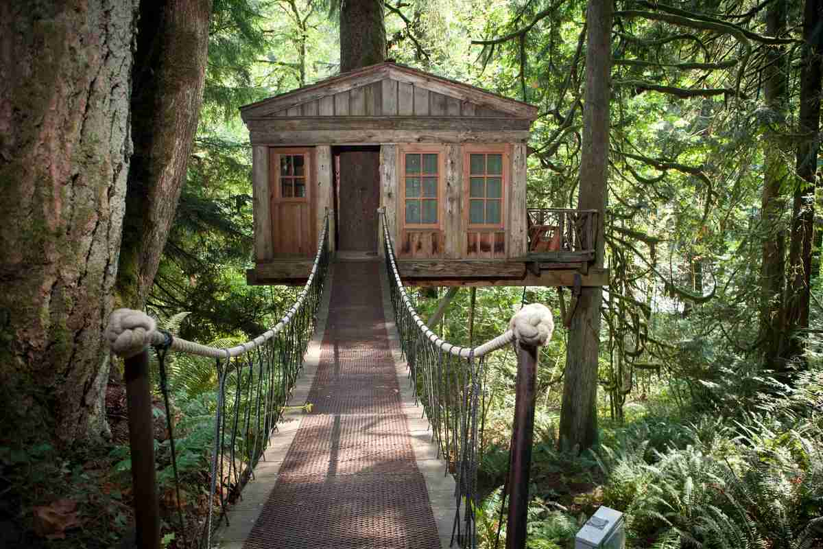 "Temple tree house has access via a wooden suspension bridge. Photo by <a href=""http://www.adamcrowley.com"">Adam Crowley</a>."