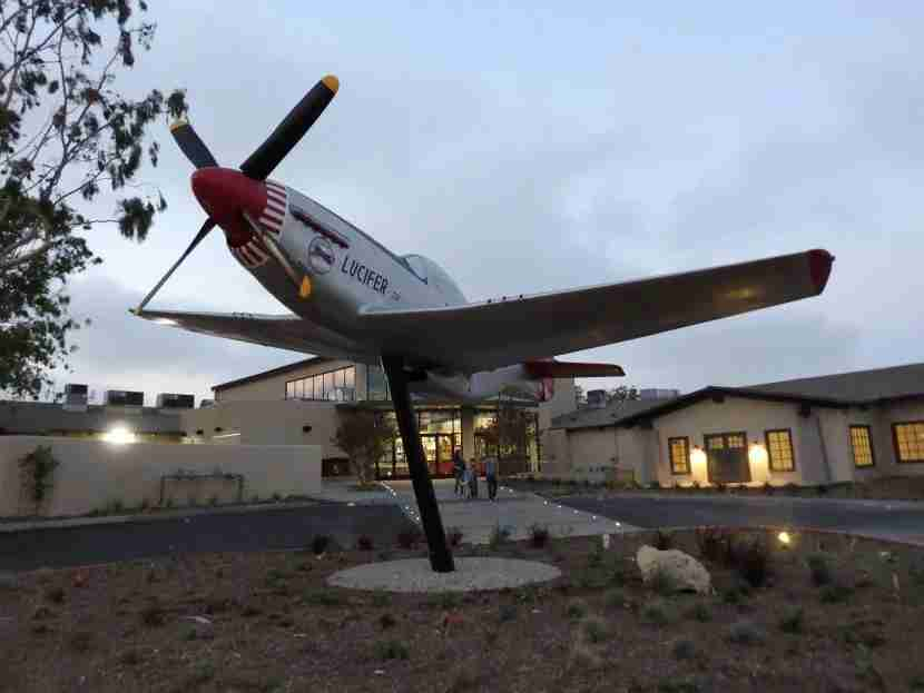 An aircraft replica honoring the Tuskegee Airmen welcomes passengers to The Proud Bird.
