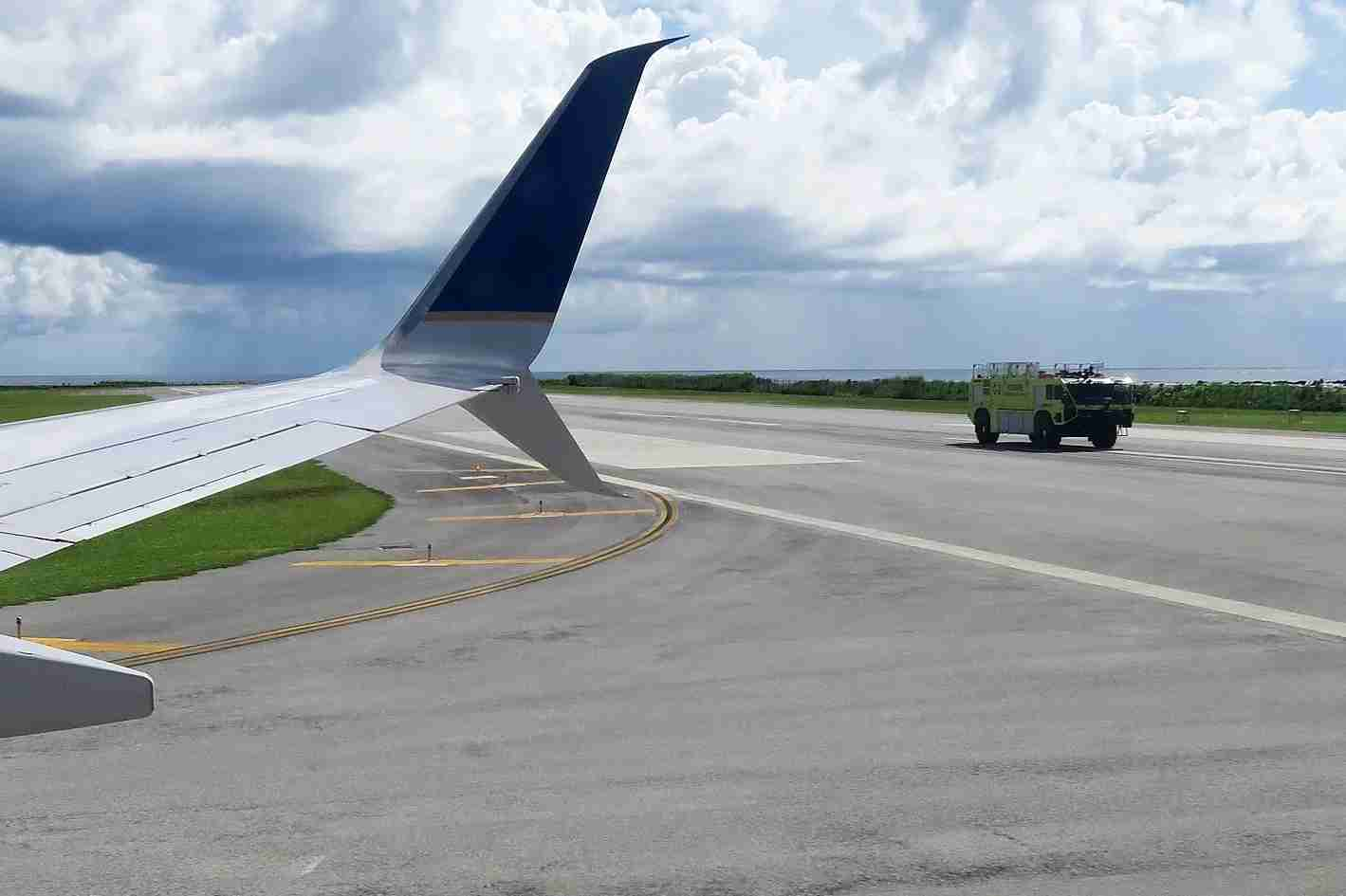 A fire truck by a United Airlines aircraft (Photo by JT Genter / The Points Guy)