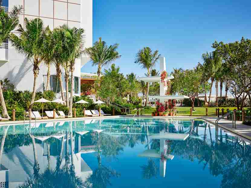 Lounge poolside at The Miami Beach EDITION. Image courtesy of the hotel.