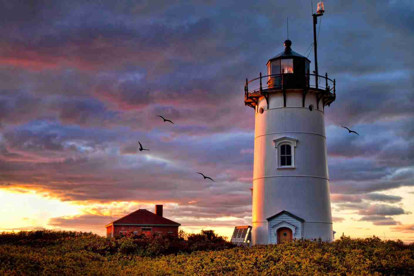 Clearing storm and dramatic skies at Race Point Lighthouse on Cape Cod.