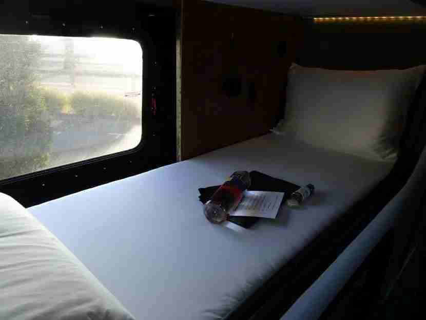 An unused sleep pod awaits the next passenger.