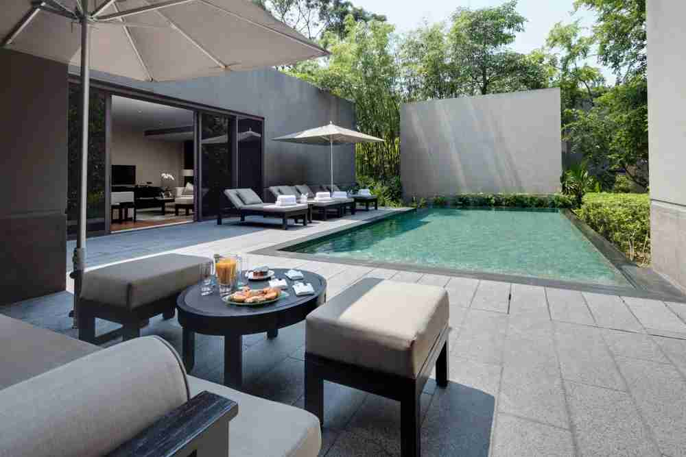 Poolside at the Contemporary Manor. Photo courtesy of Capella Singapore.