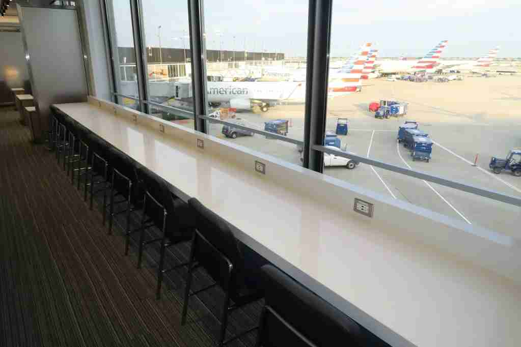 AA ORD Flagship Lounge - window seating overlooking gates