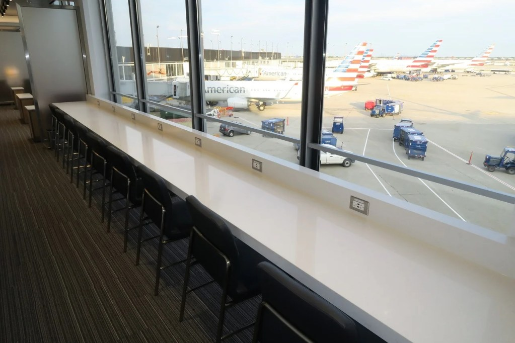AA ORD Flagship Lounge - window seating overlooking gates