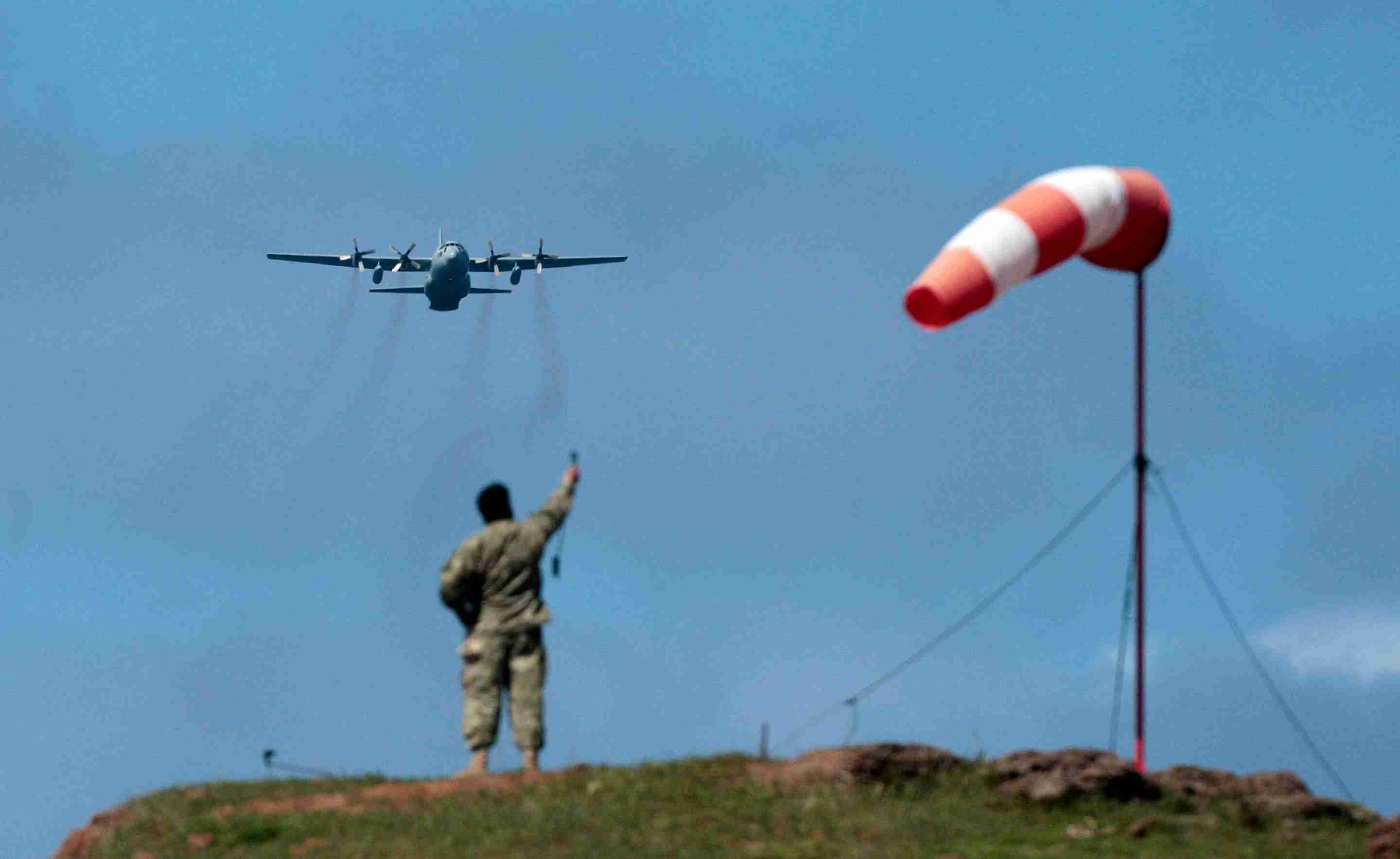 A Chilean air force soldier takes the wind speed, before a C130 Hercules aircraft with supplies and support material for the search and rescue operation of the plane that crashed on Friday droppes its load on parachute, at the Juan Fernandez (Robinson Crusoe) island airstrip on 2 September 4, 2011. Authorities resumed a search Sunday for bodies of those missing in the crash of a Chilean air force plane that is believed to have killed all 21 people aboard during an attempt to land on a remote Pacific island. Only four bodies have been recovered since the CASA 212 turbo-prop plane went down late Friday off Robinson Crusoe island, but Chilean officials on Saturday said there was no hope of survivors as all aboard would have been killed on impact. LUIS HIDALGO/AFP/Getty Images)