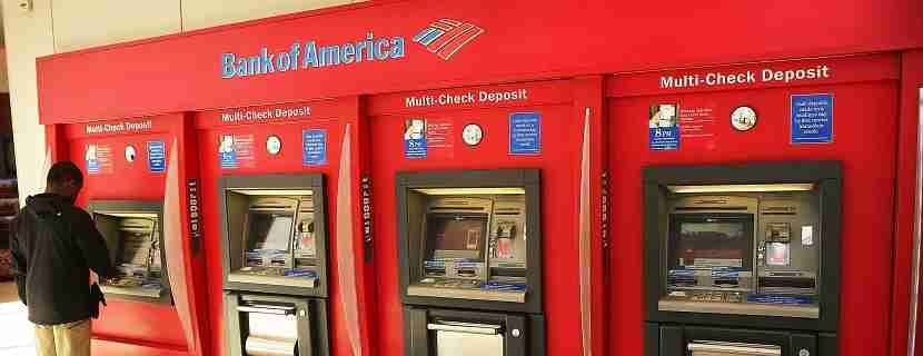 NEW YORK, NY - APRIL 16: A man uses an ATM at a Bank of America branch on April 16, 2014 in New York City. As the nation