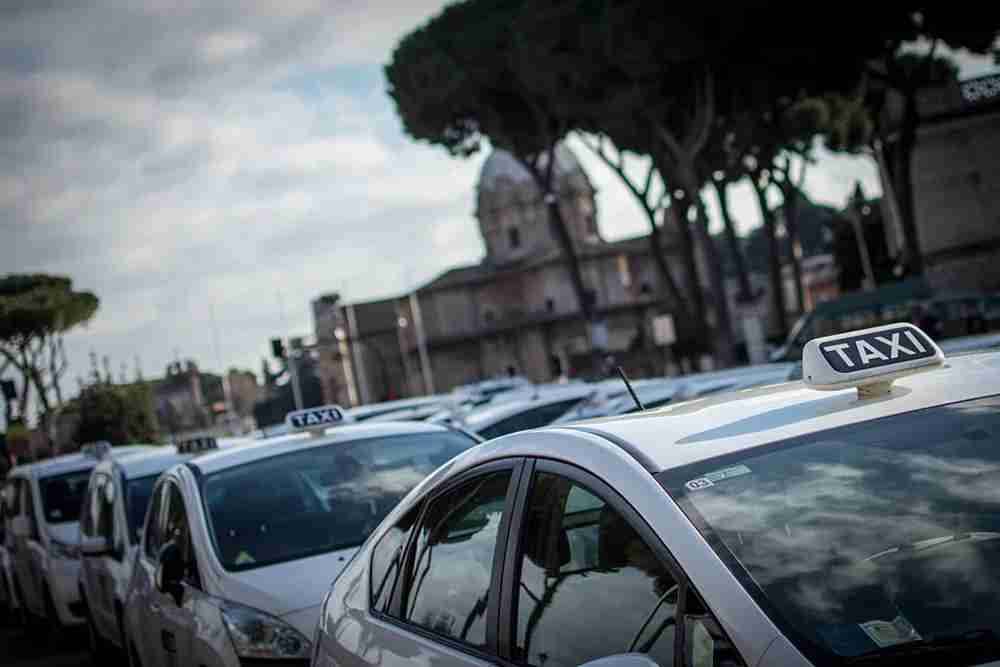 Taxis are widely available in Rome. Image by Andrea Ronchini/Pacific Press/LightRocket via Getty Images.