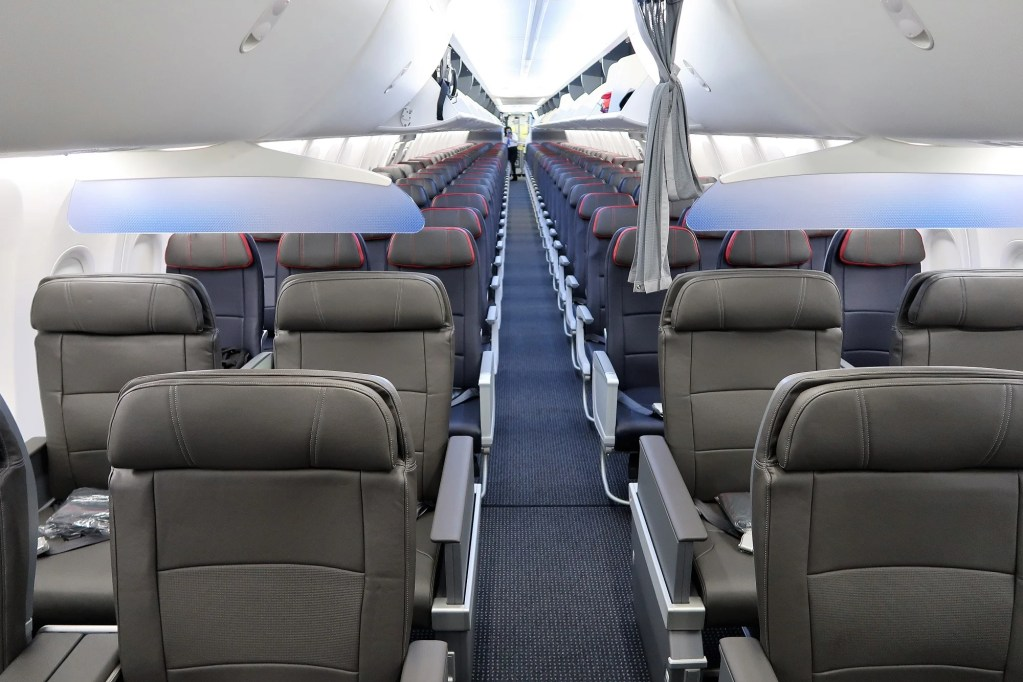 A first look inside american airlines boeing 737 max 8 although american airlines chose to keep the same number of first class seats 16 on its 737 max as its other boeing 737s the first class experience is sciox Gallery