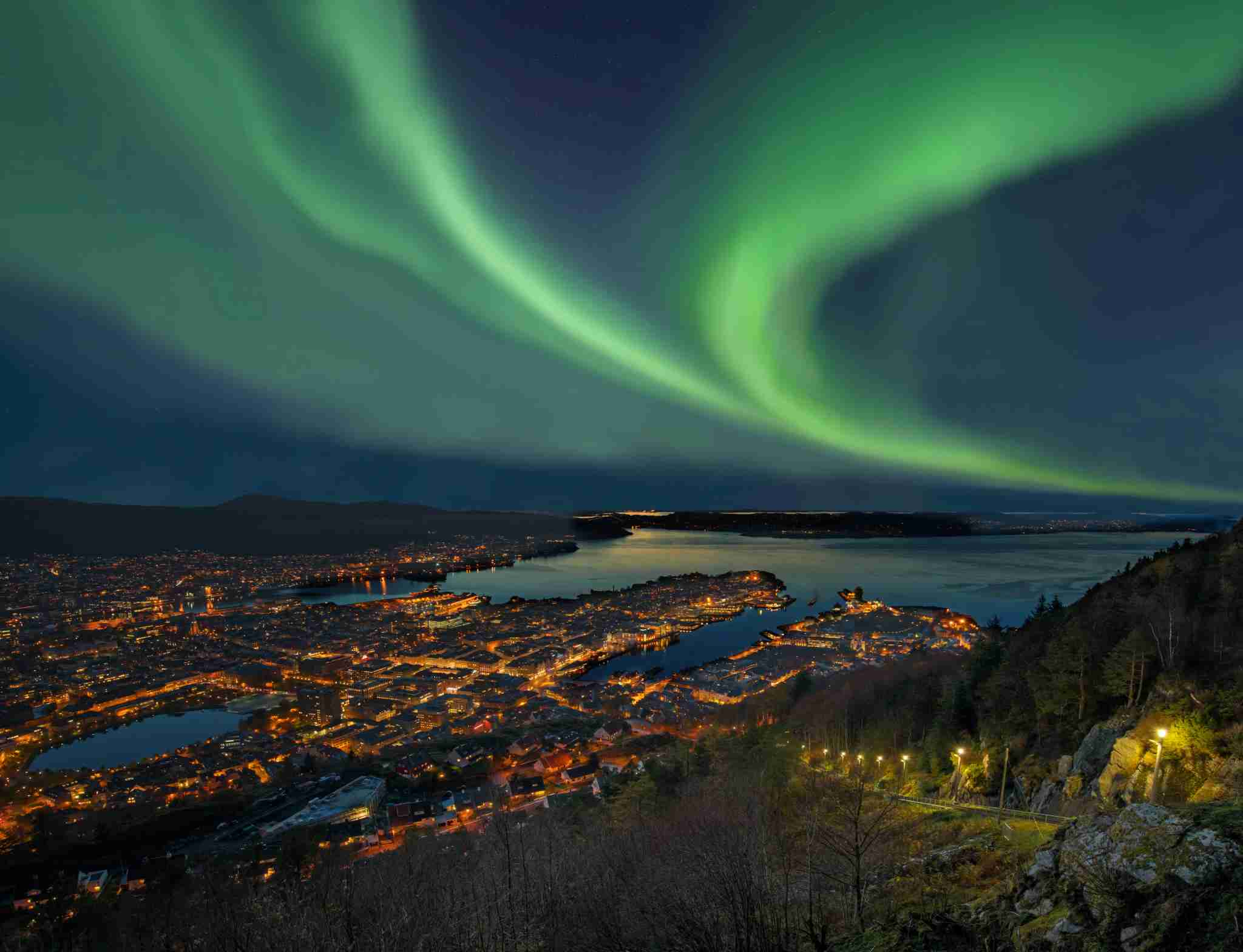 The Northern Lights over harbor of Bergen City, Norway. Image by RelaxFoto.de / Getty Image.