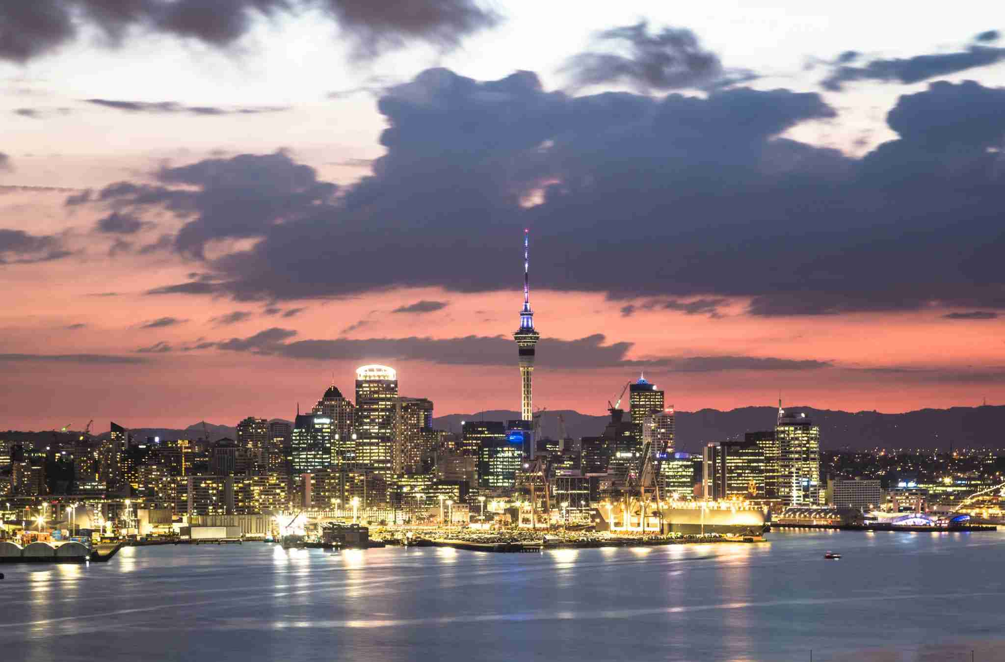 Stunning sunset over the Auckland financial district famous skyline from the viewpoint in Davenport in New Zealand