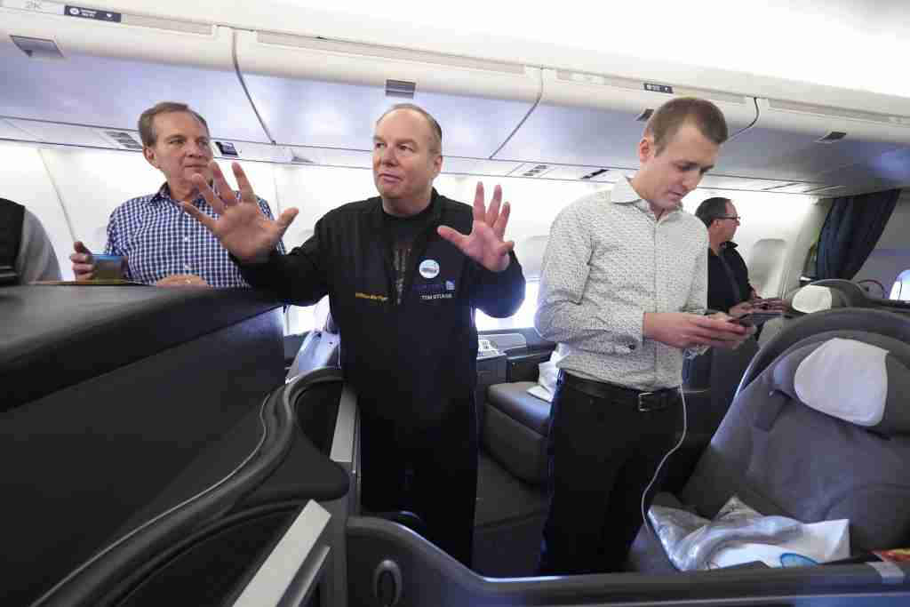 Tom chats with first-class passengers on United Flight 747.