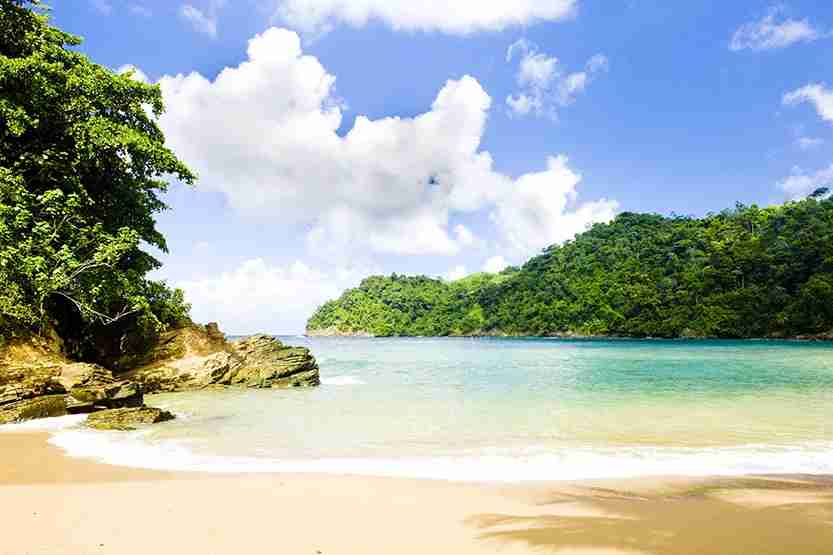 A tranquil beach in Tobago. Image by Cesar Okada / Getty Images.