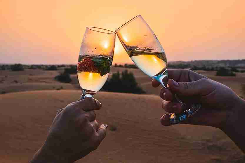 Desert sunset champagne Al Maha Desert Resort Dubai Review