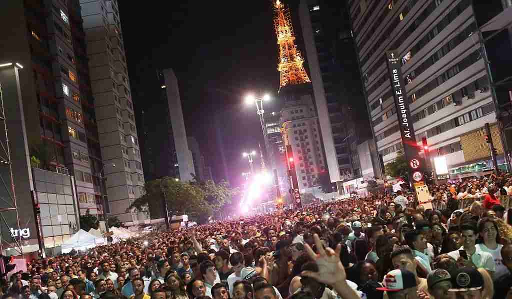 SAO PAULO, BRAZIL - JANUARY 01: Thousands of people gather to watch New Years fireworks and singer Daniela Mercury