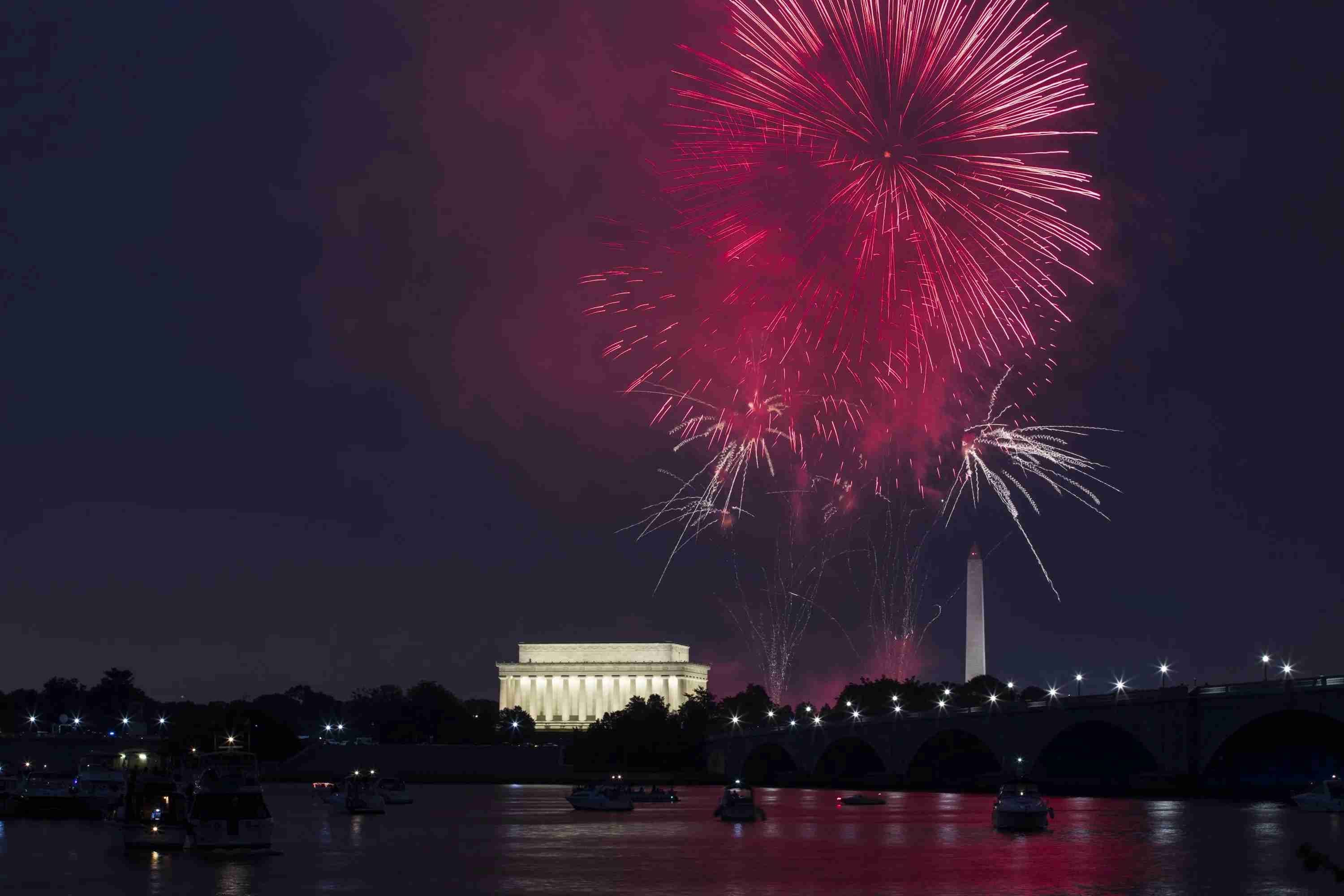 WASHINGTON, USA - JULY 4: Independence Day celebration fireworks explode in the air above the Lincoln Memorial and Washington Monument along the National Mall in Washington, USA on July 4, 2017. (Photo by Samuel Corum/Anadolu Agency/Getty Images)