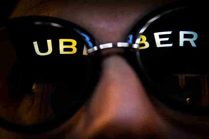 The Uber logo is seen reflected in a pair of sunglasses on November 2, 2017. (Photo by Jaap Arriens/NurPhoto via Getty Images)