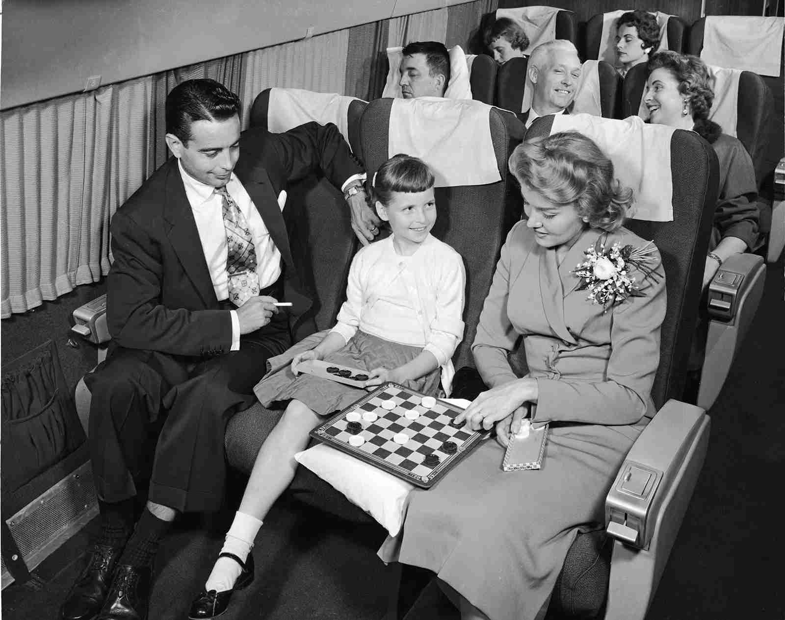 In the 1950s, smoking on board was perfectly normal even right next to children (Photo by Frederic Lewis/Getty Images)