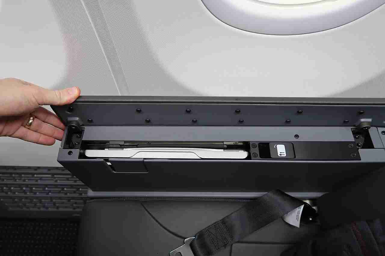 "Just make sure you check for a tray table release button before complaining about a ""broken"" tray table."