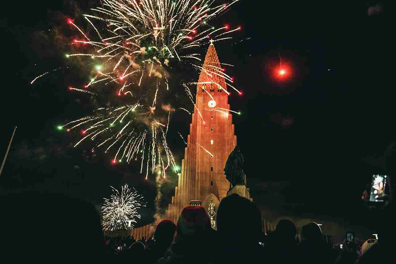REYKJAVIK, ICELAND - JANUARY 01: Fireworks go off outside Hallgrimskirkja for New Year on New Year