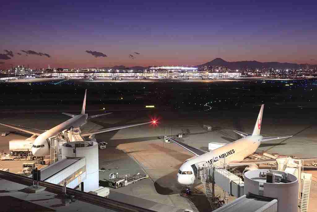 Japan, Kanto Region, Tokyo Prefecture, Ota-ku, View of Tokyo International Airport at night. (Photo by: JTB/UIG via Getty Images) (Photo by: JTB Photo/UIG via Getty Images)
