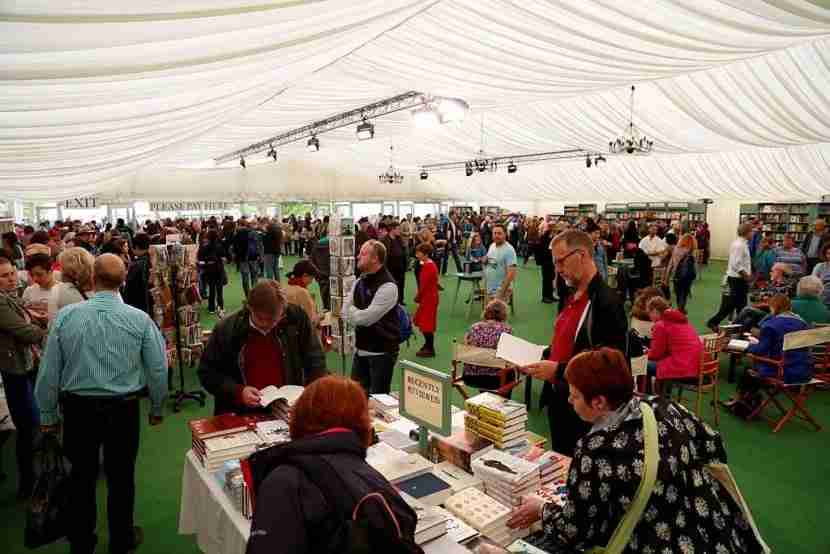 HAY-ON-WYE, WALES - MAY 29: Visitors look at books during the Hay Festival on May 29, 2016 in Hay-on-Wye, Wales. The Hay Festival is an annual festival of literature and arts now in its 29th year. (Photo by Yunus Kaymaz/Anadolu Agency/Getty Images)