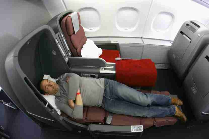 SYDNEY, AUSTRALIA - SEPTEMBER 21: A man sleeps in the new business class seat onboard the new Qantas A380 flagship the