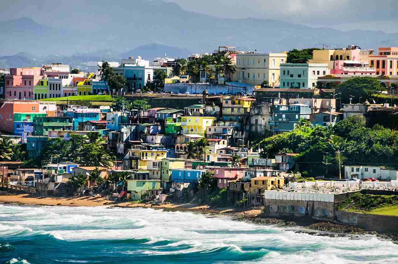 Bright, pastel colors of houses in a neighborhood of San Juan, Puerto Rico. Photo by Ken Wiedemann / Getty Images