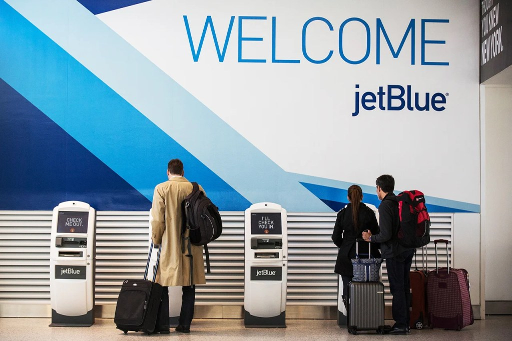 NEW YORK, NY - APRIL 23: Customers check in at JetBlue