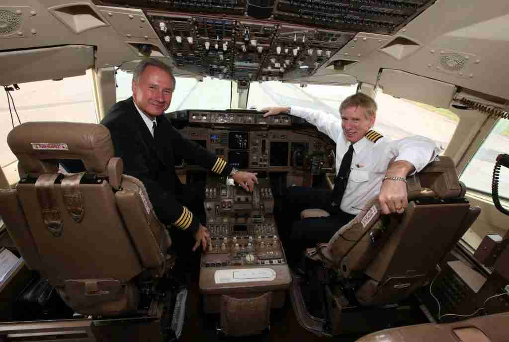 Pilots Captains John Dunkin (left) and Jay Galpin after flying Businessman American tycoon Donald Trump
