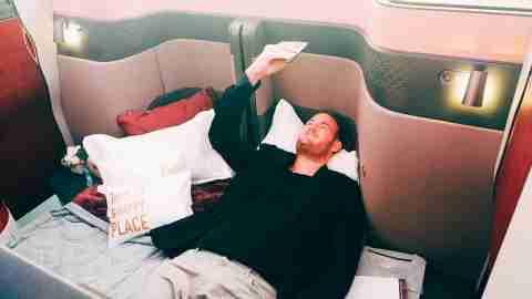 Qatar-Airways-unveiling-ceremony-TPG-testing-lie-flat Brian Kelly