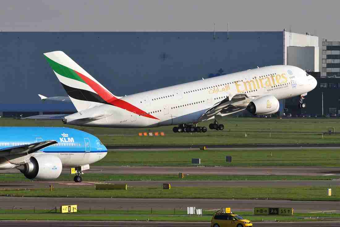 An Emirates Airbus A380 takes off and a KLM 777 taxies, seen from the observation terrace (Photo by Alberto Riva / The Points Guy)
