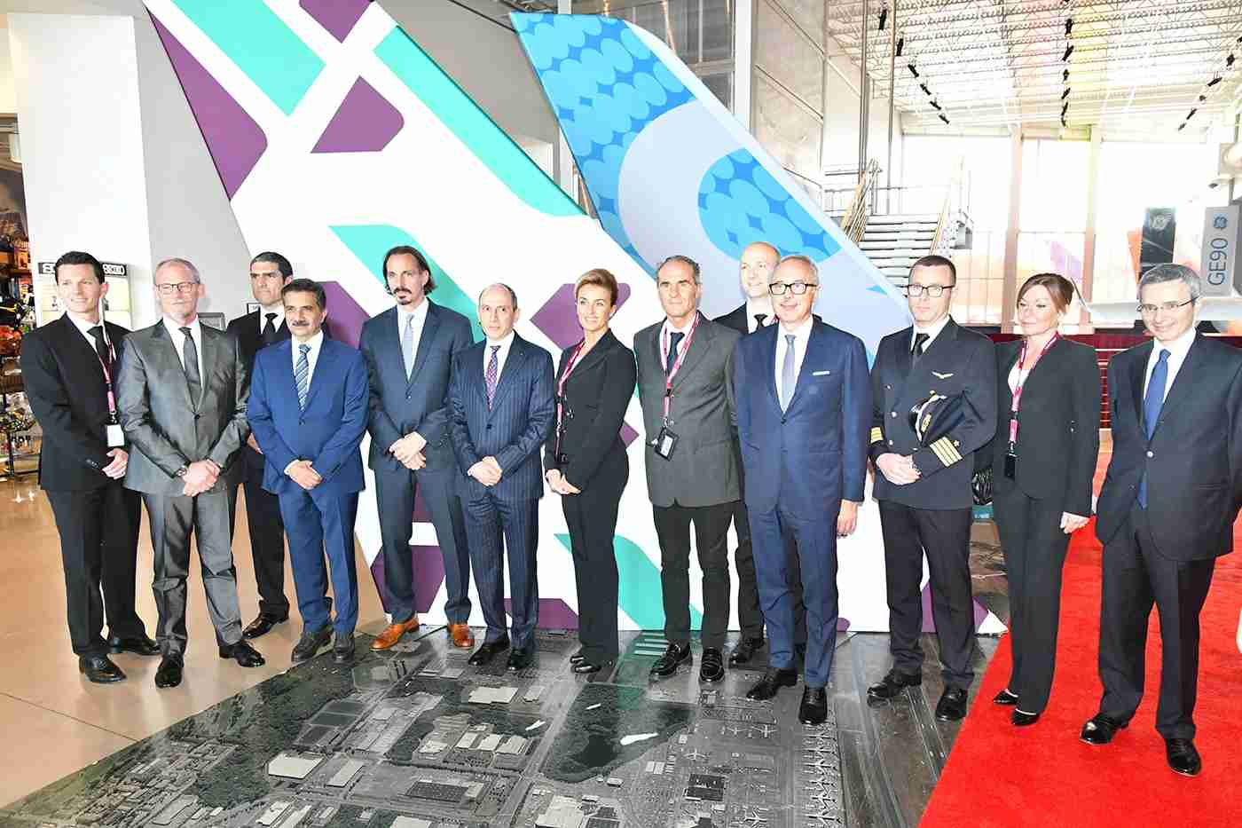 Akbar al Baker (center, in pinstripes) with dignitaries including Air Italy chairman Francesco Violante (4th from R) and Marco Rigotti (1st on R), chairman of Alisarda, which owns 51% of Air Italy