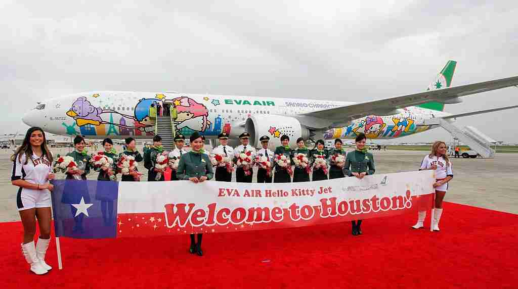 HOUSTON, TX - JUNE 19: The flight crew of EVA Air Hello Kitty Shining Star Jet - Inaugural Event at George Bush Intercontinental Airport on June 19, 2015 in Houston, Texas. (Photo by Bob Levey/Getty Images for Sanrio)