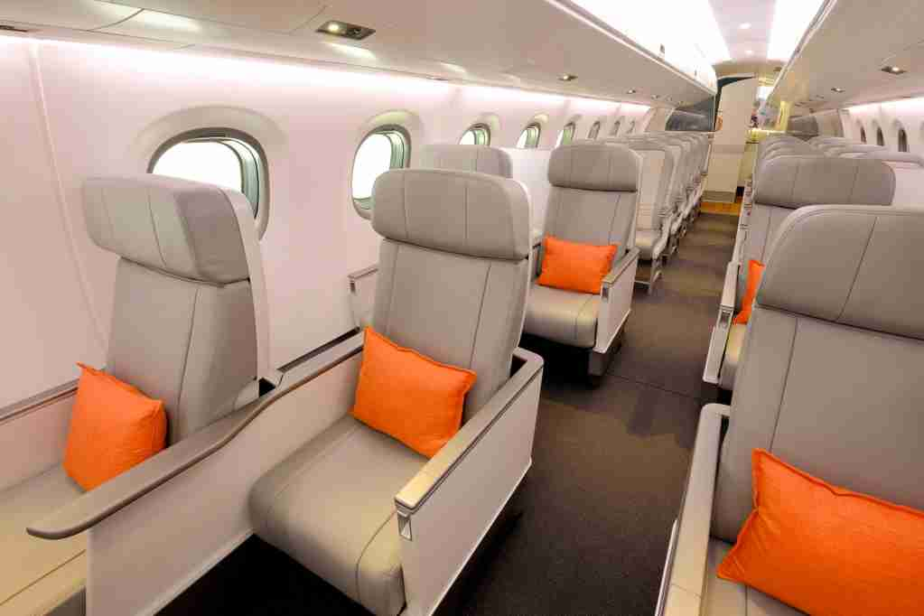 The cabin does have an all-business class feel, with unique staggered seats in business. Image via Embraer.
