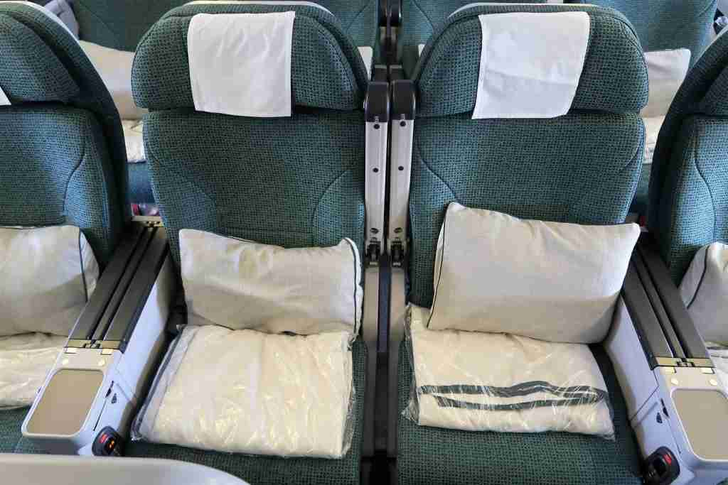 In addition to having more space between the armrests, the middle armrests on the 777 fold up for even more space.