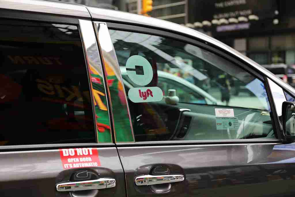 NEW YORK, NY - JULY 30: A Lyft ride hailing vehicle moves through traffic in Manhattan on July 30, 2018 in New York City. After a significant increase in local traffic and a spate of suicides by taxi drivers, New York City is planning to vote on capping ride-sharing services such as Uber and Lyft. The City Council