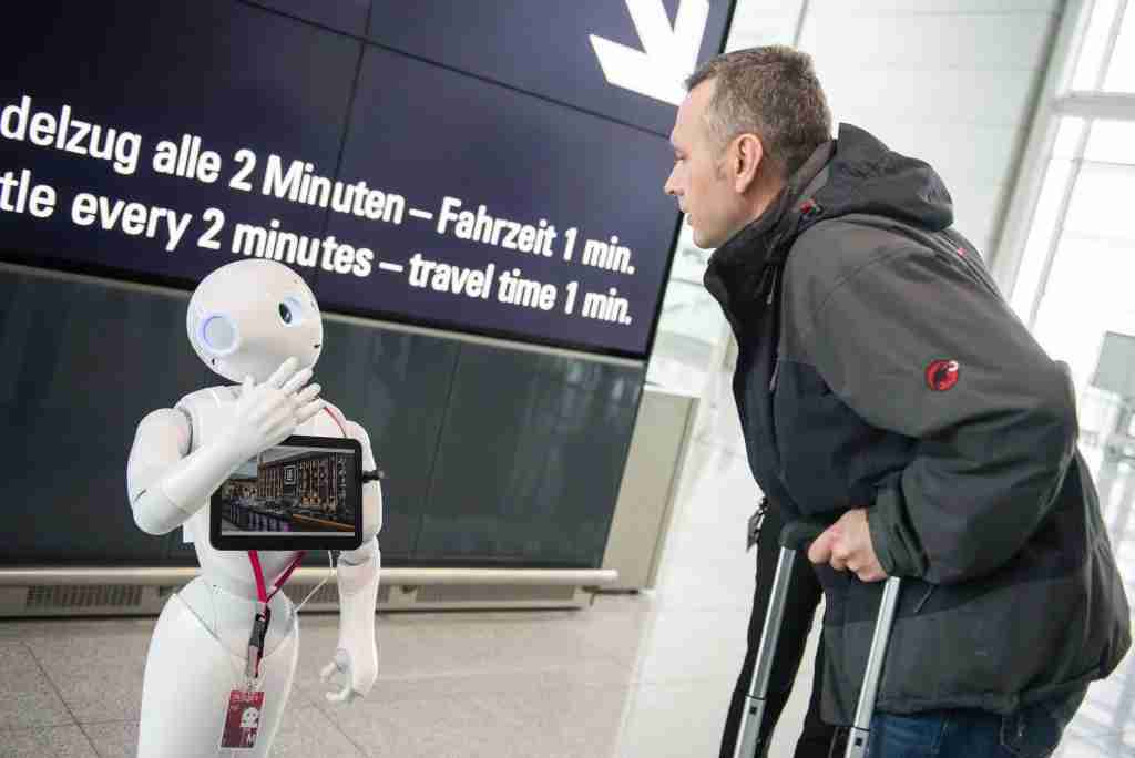 Robot Josie Pepper assists passengers travelling from the airport in Munich, Germany, 20 February 2018. Pepper is a humanoid robot programmed to analyse and emulate human gestures and facial expressions. Photo: Lino Mirgeler/dpa (Photo by Lino Mirgeler/picture alliance via Getty Images)
