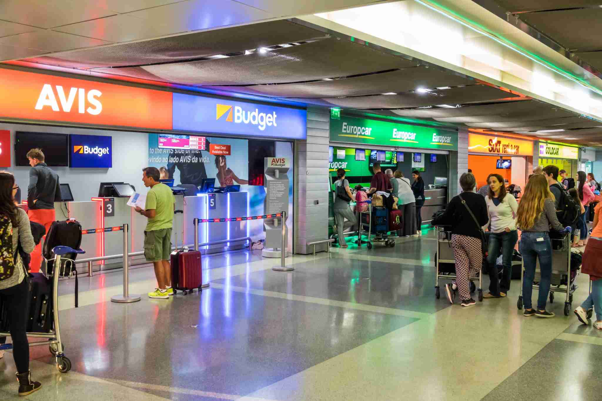 Portugal, Lisbon, Humberto Delgado Airport, competing car rental counters, Avis, Budget, Europcar. (Photo by: Jeffrey Greenberg/UIG via Getty Images)